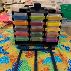 30 like new Whisper Stamp Pads in storage caddy.